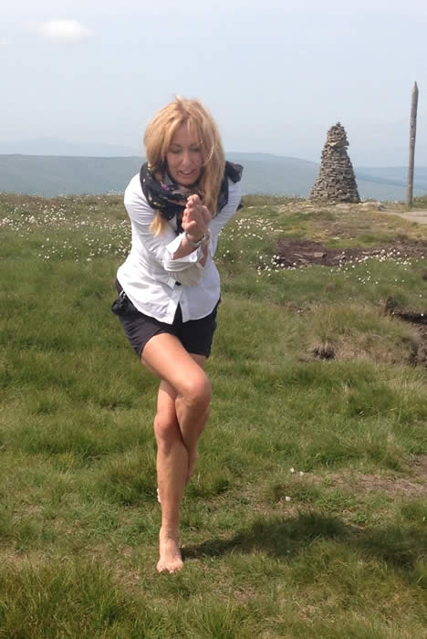 Picture of Anne Harrison of Bodies Yoga practicing a yoga posture outdoors