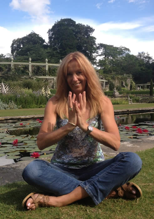 Picture of Anne Harrison of Bodies Yoga practising the Lotus position